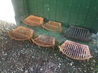 Vintage cast iron fire grates.