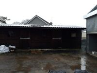Four 12x12 wooden stables
