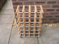 A 24 bottle metal and wood wine rack.