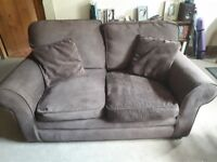 2 chocolate sofas. 85cm deep and 160/180cm wide. Under 4 years old and from pet & smoke free home.