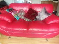 Red leather and chrome sofa