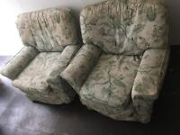 2 padded floral armchairs