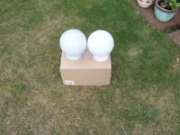 Two used globe style light fittings