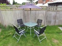 Garden Table, four chairs and an Umbrella