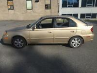 Hyundai Accent 2005 gold great condition NEGOTIABLE