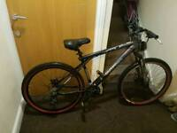 GT mountain bike with 26 inch wheel size and M frame