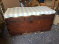 Wooden storage chest with seat cushion