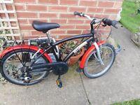 boys red and black 20 inch wheeo bike