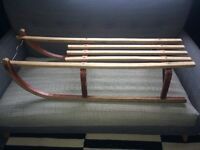 Original/ retro wooden sledge with metal runners.