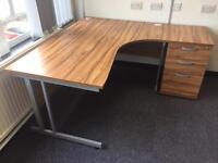Corner desk with pedestal.