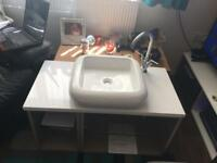 Wall hung new Tavistock unit with worktop, tap and basin