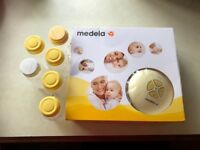 Medela Swing Electric Breast Pump and 6 additional storage bottles