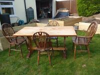 Antique dining table and 4 wheelback chairs including 2 carvers
