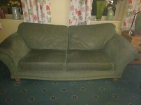 Extra large quality green sofa.