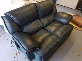 2 leather electric reclining sofas , good condition , non smoking house , no couriers