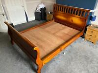 King size solid wood sleigh bed.