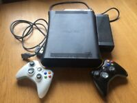 Xbox 360 for sale with 2 wireless controllers.