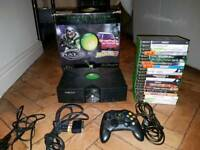 Original Xbox Console With 1 Control Pad, 20 Games, Box and Instructions manual.