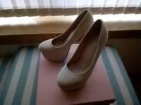 Cream high heels, size 4