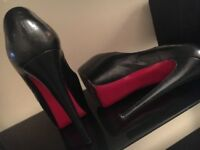 Very well worn Christian Louboutin high heels size 5