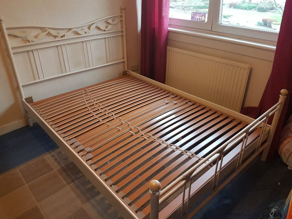 Metal frame double bed with slats. Good condition