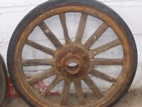 vintage large wood and rubber wagon wheel