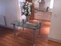 Large Glass Extendable Dining Table For Sale