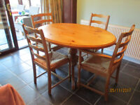 PINE OVAL TABLE AND FOUR CHAIRS