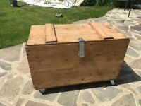 Large wooden trunk on wheels coffee table