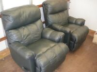 2 GREEN LEATHER RECLINER CHAIRS at Haven Housing Trust's charity shop