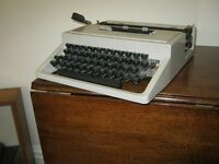 Olivetti Dora Typewriter in original carrying case with operating sheet . Suit collector .