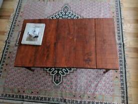Reclaimed industrial style coffee table with wooden top and copper legs
