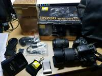 Nikon d5200 with 18-55 and 55-200 lenses. 2 batteries. Bag. Accessories. All boxed