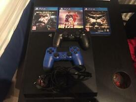 PS4 with two controllers & 4 games