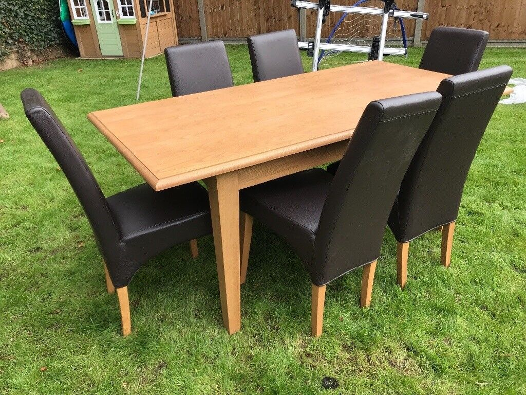 Table and 6 brown leather chairs 6x3