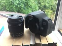 Canon 700D with kit lens and additional batteries (missing lens hood)