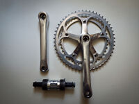 Vintage Shimano Golden Arrow crankset with bottom bracket cartridge.