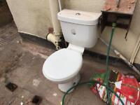 Toilet and wash hand basin with taps