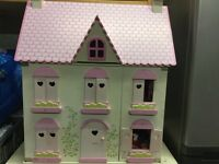 Dolls house with furniture from ELC Rosebud Country Cottage