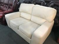 As new cream leather 2 seater sofa