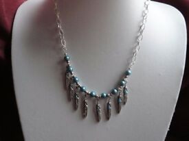 Feather and bead necklace