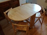 Folding Table and 4 Chairs in Excellent Condition that folds down to 1 foot wide