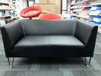 Two Seater Sofa, Black Leather Vinyl. Good Condition! 2 Available.