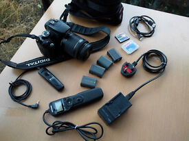 Canon 350D (with new lens) + full photography starter kit (including tripod)