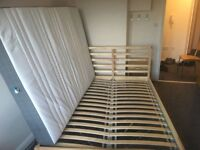 Ikea double bed frame plus mattress almost new for 120£