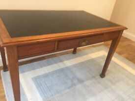 Leather top traditional desk with one drawer in middle. Very good condition