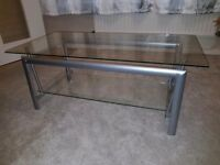 Coffee table with glass top and metal frame