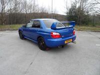 Blue Subaru Impreza WRX (STI rep)