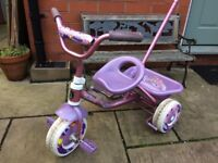 Kid's ride on and push along tricycle