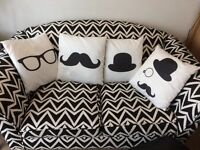 Four Made .com black/white cushions in excellent condition - moustache, glasses, bowler hat.